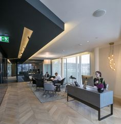 This reception area at CBRE has an effortless elegance, wth a table-style reception desk, long hanging ceiling chandelier and clever spot lights in the painted bulkhead ceiling. The wooden floors help to create a more homely look and feel. See the video of this cool transformation by clicking the image: