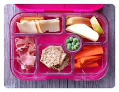 Cheese slices, antibiotic-free prosciutto, brown rice crackers, frozen peas, carrots, and apples.