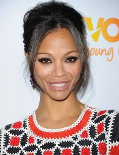 Try a pretty (and practical) updo if you plan on spending a lot of time in transit this holiday season. To get Zoe Saldana's gorgeous look, tease the crown of your hair for extra oomph and then sweep back your locks into a loose updo. Leave out a few face-framing pieces for a chic look that'll last when you make the holiday party rounds.