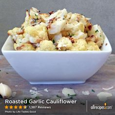 Roasted Garlic Cauliflower | Tender roasted cauliflower is topped with Parmesan and cheese and broiled until golden brown.