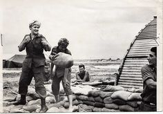 2nd Lt Mary Lemieux, ANC throwing a sand bag to PFC James Liso 7th Surgical Hospital 1966 Cu Chi by Mary Lemieux