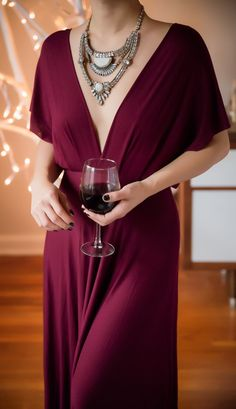 Plunging wine maxi dress with statement necklace