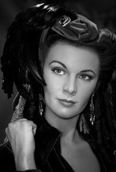 Vivien Leigh with a feather in her hat black and white photo looking serious