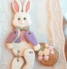 Hinged Easter Bunny Cookies. March McGoo U Tutorial: basket weave piping, piped roses, dimensional face, eye transfers