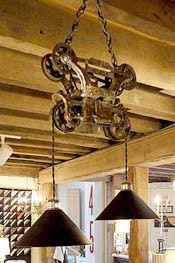 "Bogwater Jim  Lafayette, NJ 07848  973 383-6057  Hanging lights envisioned from old industrial parts are more than just ""Antiques Made While..."