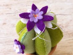 Green felt cactus pincushion with purple flowers and hand Felt Flowers, Purple Flowers, Flower Pots, Cactus Flower, Easy Felt Crafts, Felt Pincushions, Felt Banner, Felt Baby, Sewing Projects For Beginners