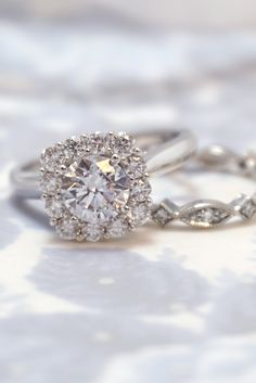 This white gold halo engagement ring by Sylvie Collection features .79 carats of diamonds around the halo. Any shape or size of diamond (or any other gem) can be used in the center. This classic engagement ring evokes elegant, floral tones. We can also customize it to fit your style. TAP for more info and discover 1,000+ unique engagement rings!