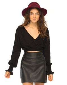 Wrap style blouses are so hot right now. Check out this flirty and flattering wrap crop, featuring long gathered bell sleeves and a gathered wrap over hemline http://www.motelrocks.com/products/Edna-Wrap-Crop-Blouse-in-Black-by-Motel.html