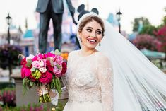 Hot pink rose and peony bridal bouquet at a Disneyland bridal portrait session