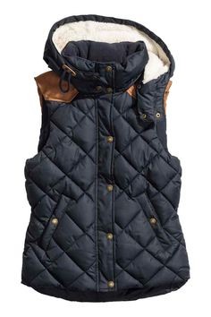 Fitted, padded vest with imitation suede details. Fleece-lined stand-up collar, detachable pile-lined drawstring hood, zip and wind flap at front with snap fasteners, and fleece-lined side pockets with snap fastener. Jackets For Women, Clothes For Women, Ladies Jackets, Quilted Vest, Outerwear Women, Autumn Winter Fashion, Ideias Fashion, Fashion Online, My Style