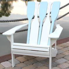 Boat oar Adirondack Chair in blue and white. Learn more about this all American chair: http://www.completely-coastal.com/2009/07/adirondack-chair-from-mountains-to.html