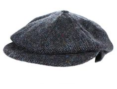 The newsboy cap features a denim background with a lovely Donegal fleck for a touch of color, and is crafted from eight patches brought together by a button at the peak. The cap is made from 100% pure new wool for durability and comfort with an integrated bill and peak that extends and curves to shade your eyes from the various elements. The 8 piece cap is made by John Hanly & Co. located in Co. Tipperary, Ireland.