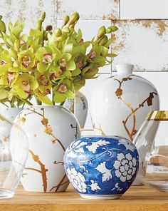 Handpainted 10K gold cherry blossoms adorn these ceramic vases crafted in a region of China where ceramics have been produced since the Han Dynasty in 206 BC. Each is hand-thrown, kiln dried and then glazed.