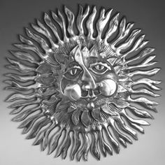 If you're looking for a dramatic large wall piece, look no further than this Large Sun with Rays