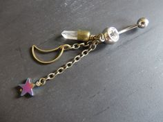 Lovely one of a kind quartz crystal, moon and star belly ring. www.azeetadesigns.etsy.com