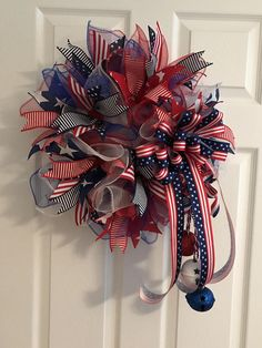 This wreath pops with red white and blue color. Show your patriotic pride on the Fourth of July, Memorial Day, Veterans Day, Presidents Day, Labor Day or anytime of the year. I used red white and blue premium deco mesh to make this wreath. And accented throughout with Stars and Stripes ribbon, red and white stripe ribbon, navy and white stripe ribbon and navy ribbon with white stars. I then attached a bow made of flag Stars and Stripes ribbon and then I added a string of red white and blue…