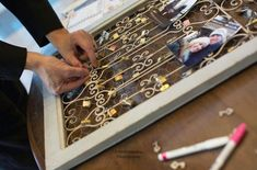 Guests each sign a lock, lock it on the grate, and put the key in a shadowbox as a guest sign-in book - Just like the love lock bridge in Paris!
