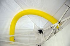 Pool noodles can be curved and inserted between the canopy top fabric and upper frame to keep water from collecting and potentially collapsing the roof during rainstorms.