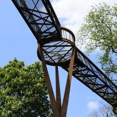 An elevated walkway through the trees by Marks Barfield Architects has opened at Kew Gardens in London