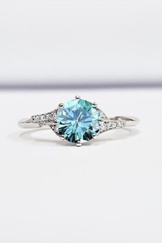 Check this moissanite unique engagement ring to set her heart aflutter. Designed in striking detail, the band features a twist motif with a variety of side natural diamonds. A large focal forever brilliant moissanite sits atop in all its splendid glory.