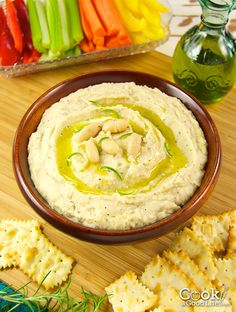 If you love hummus, you are going to enjoy this Italian version. This simple recipe for white bean dip is filled with flavor including roasted garlic, rosemary, and lemon zest. Delicious with crackers, crostini, and as a vegetable dip.