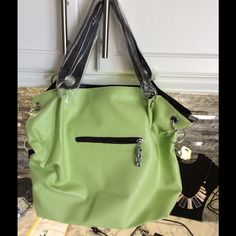 "On Trend Fashion Satchel in Edgy Lime and Black. Great bag all around. Measures 12"" across by 11"" deep. Flat measure is over 4"" ! Interior sports many pockets with hidden zip pocket for added security.  Flat black bottom. Bag is vegan leather with oh so soft touch ! Comes with adjustable shoulder strap in addition to handles with an9"" drop. Zip closure.  Bag accented by silver hardware. Weidipolo Bags Satchels"