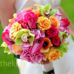 Brightly colored roses, hydrangeas, calla lilies, and cymbidium orchids