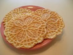 Pizzelle... thin wafer cookies.  Italian Christmas time favorite.  Dust with powdered sugar.  Yum