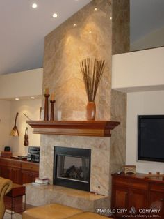 floor to ceiling granite fireplace very dramatic