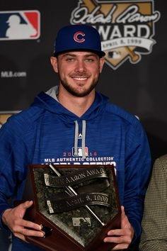 2016 Hank Aaron Award National League recipient Kris Bryant #17 of the Chicago Cubs poses prior to Game Two of the 2016 World Series between the Chicago Cubs and the Cleveland Indians at Progressive Field on October 26, 2016 in Cleveland, Ohio.