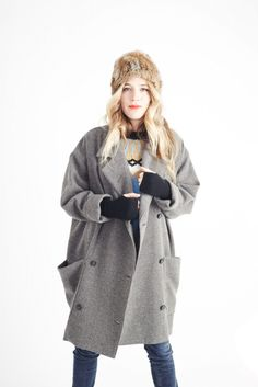 This is from smythe, a double breasted coat with exageraatted pockets incorporated into a shoulder princess seam.