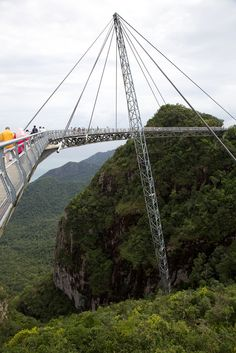 Langkawi Sky Bridge is a 125 meters curved pedestrian cable-stayed bridge, located at the peak of Gunung Mat Chinchang mountain, on Pulau Langkawi, an island in the Langkawi archipelago in Kedah, Malaysia. Sky Bridge, Pedestrian Bridge, Machu Picchu, Places To Travel, Places To See, Pictures Of Bridges, Scary Bridges, Cable Stayed Bridge, Famous Bridges