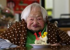 Misao Okawa, who is recognised by Guinness World Records as the world's oldest woman, receives a cake during her 115th birthday celebration ...