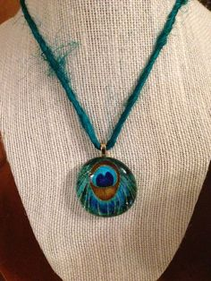 Peacock pendant on silk