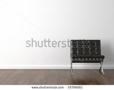 interior design of black barcelona chair on a white wall - stock photo
