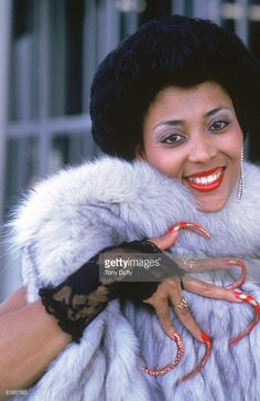 Florence Griffith Joyner poses for a portrait in Black Stiletto Nails, Sexy Nails, Long Fingernails, Long Nails, Roxy, Flo Jo, Free Black Girls, American Athletes, Vintage Black Glamour