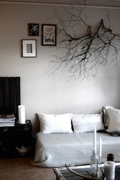 gotta try this some day, via http://style-files.com/2010/12/27/branch-as-wall-decoration/