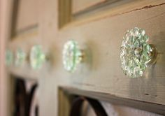 added anthropologie knobs to a vintage door in our bathroom for towels