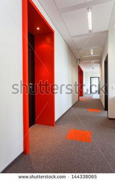 Corridor with colorful floor and door frames - stock photo
