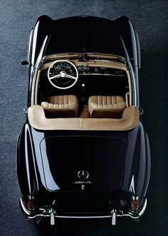 Mercedes-Benz 190 SL. I'm not crazy about cars, but doesn't that just look fun, cozy?
