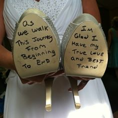 The groom writes on the bride's shoes before the wedding. The bride doesn't peek until putting them on right before walking down the aisle.