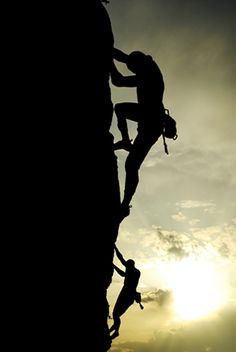 rock climbing, in silhouette. This scares me to death, but I'd love to try.