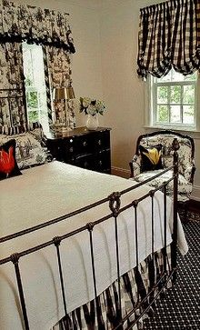 Like the black bedside chest and wrought iron bed...don't love all of the fluff