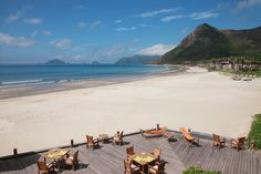 Open air dining on a stunning beach at Six Senses Con Dao's By the Beach restaurant, Vietnam