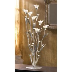 Buy Silver Calla Lily Candle Holder at wholesale prices. We offer a large selection of cheap Wholesale Candle Holders. If you need Silver Calla Lily Candle Holder in bulk at a discount price then buy from WholesaleMart. Unique Candle Holders, Unique Candles, Tealight Candle Holders, Tea Light Candles, Tea Lights, Lys Calla, Calla Lillies, Glass Candelabra, Candle Chandelier