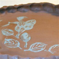 rubber stamp with slip or underglaze onto wet or leatherhard clay