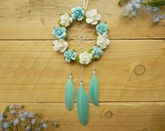 A personal favorite from my Etsy shop! Beautiful turquoise flower car dreamcatcher: https://www.etsy.com/ca/listing/279806170/aqua-flower-dreamcatcher-car-accessory