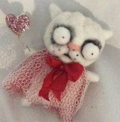 Hand needle felted from a combo of wools. Approx 4 ... Swarovski crystal sparkle on ribbon .