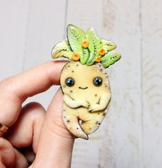 A cute Mandrake pin that lets everyone know what your favorite class is, despite the screams. | 31 Spot-On Gifts For The Hufflepuffs In Your Life