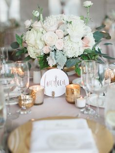 Elegant, and romantic reception. Blush rose centerpiece and gold table setting inspiration.